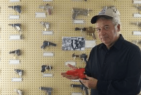 """J.M. Davis Arms and Historical Museum Executive Director Wayne McCombs displays a toy gun, part of promotion for Carrie Underwood's new song, """"Little Toy Guns."""""""