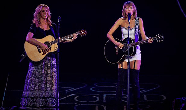 """Read more about the article Taylor Swift Gets a Little Help From a """"Friend"""" (Watch!)"""