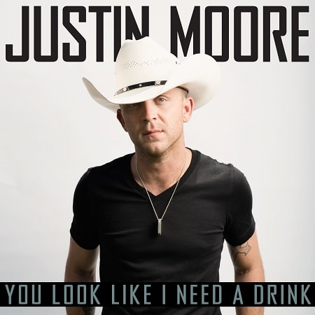 Justin Moore has a new single. Take a listen to 'You Look Like I Need A Drink'