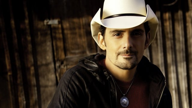 Brad Paisley looks just THRILLED to pose with Donald Trump