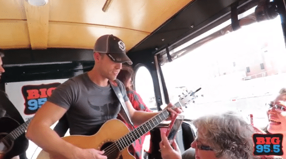 Dustin Lynch performs on a Chicago trolley