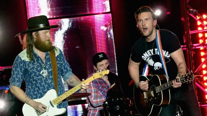 Brothers Osborne Play a Concert on Bus After Venue Ceiling Collapses