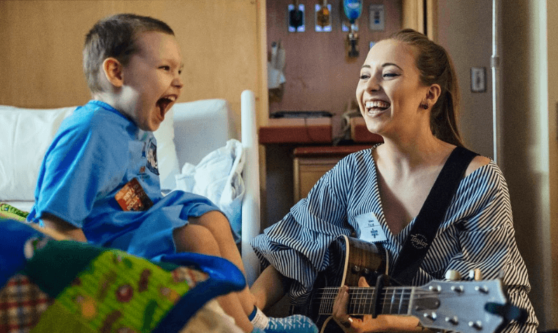 Read more about the article Musicians On Call Teams Up with Radio Disney & Song Suffragettes to Bring Music to Patients