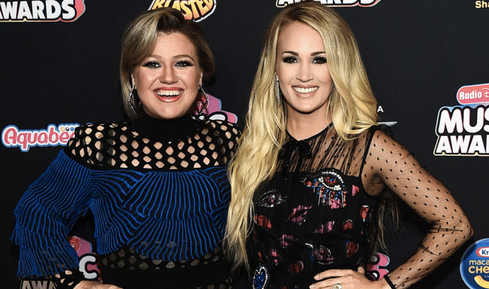Read more about the article Kelly Clarkson Squashes Rumors of a Feud with Carrie Underwood