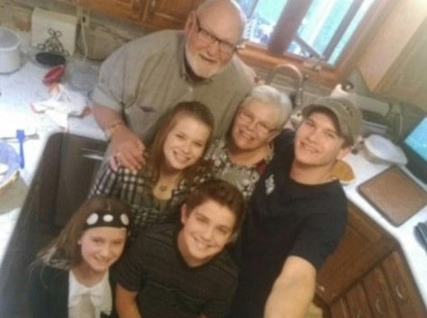 Jim with grandkids
