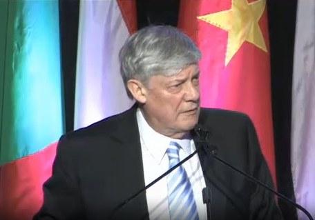 Dr. Dodds delivering a speech