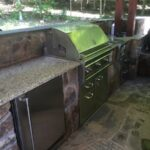 Outdoor grilling area and under cabinet refrigerator