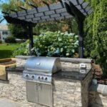 Outdoor kitchen gas Grill built-in under pergola