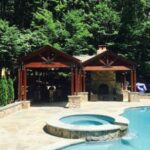Pool pavilion outdoor kitchen and fireplace