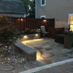 Integrated lighting at seat wall and fence