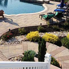 Pool area landscaping with steps