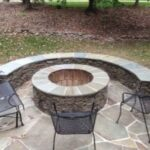 Round Stacked Stone Fire Pit and Stone Seating