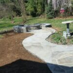 Stone Fire Pit with Flagstone Pathway