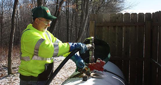 photo of EDP employee filling a propane tank