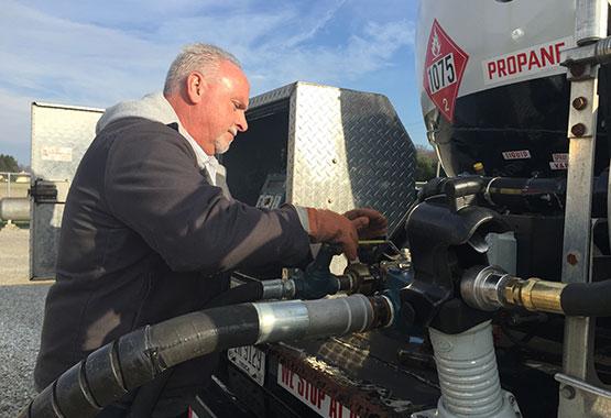 photo of Gary filling a propane tank