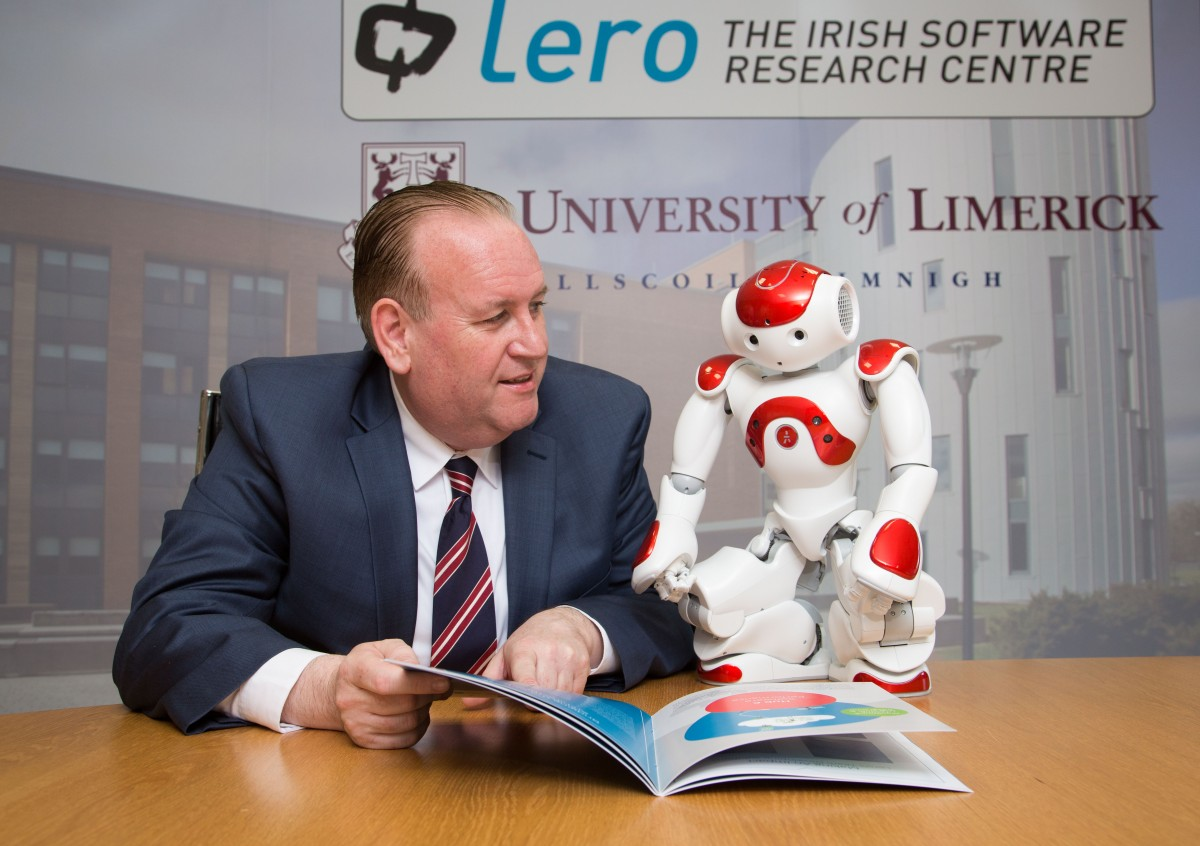 Professor Mike Hinchey, director of Lero, the Irish Software Research Centre, with robot assistant.