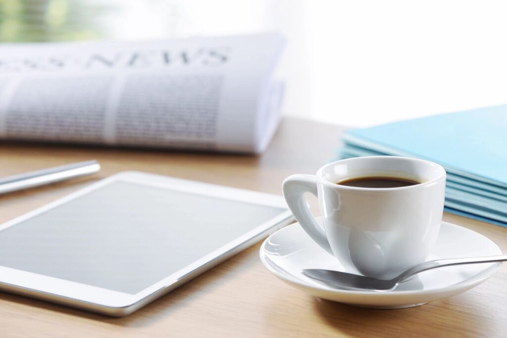 newspaper and coffee table