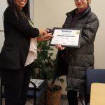 Hannah Y. receives her certificate.
