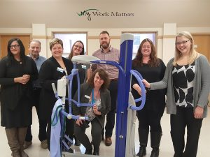 DDRC employees after finishing up training on how to use the new mobile lift.
