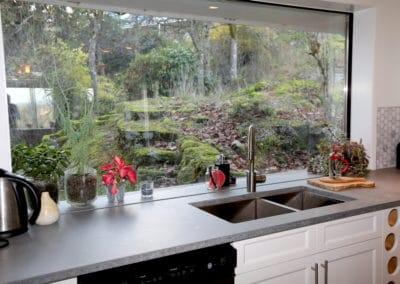 white-cabnets-Grey-counterop wiht big window Exotic-Stone-Counteropts
