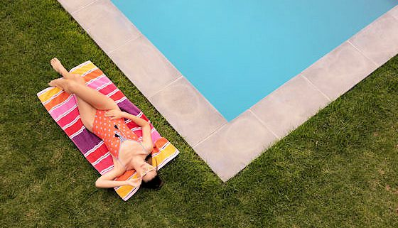 How Care for Your Lawn Without Hurting Your Pool
