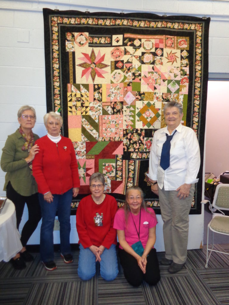 Throw communique quilt made by a local quilt guild. Shared via email.