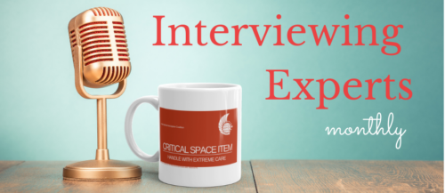 A microphone near a coffee cup. Text: Interviewing Experts