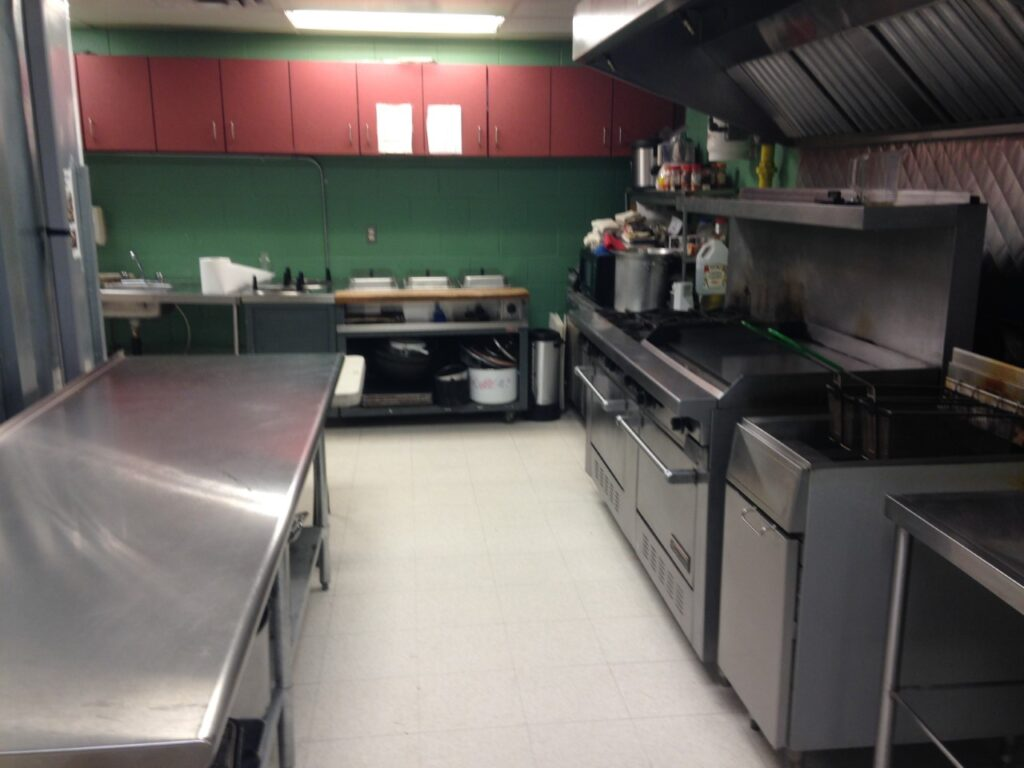 The kitchen, which is off to the right side of the gym/hall has a variety of stove ranges, refrigerators and cookware to use.