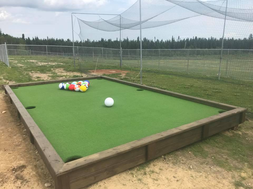 Snookball combines soccer and billiards outside on a giant looking pool table.