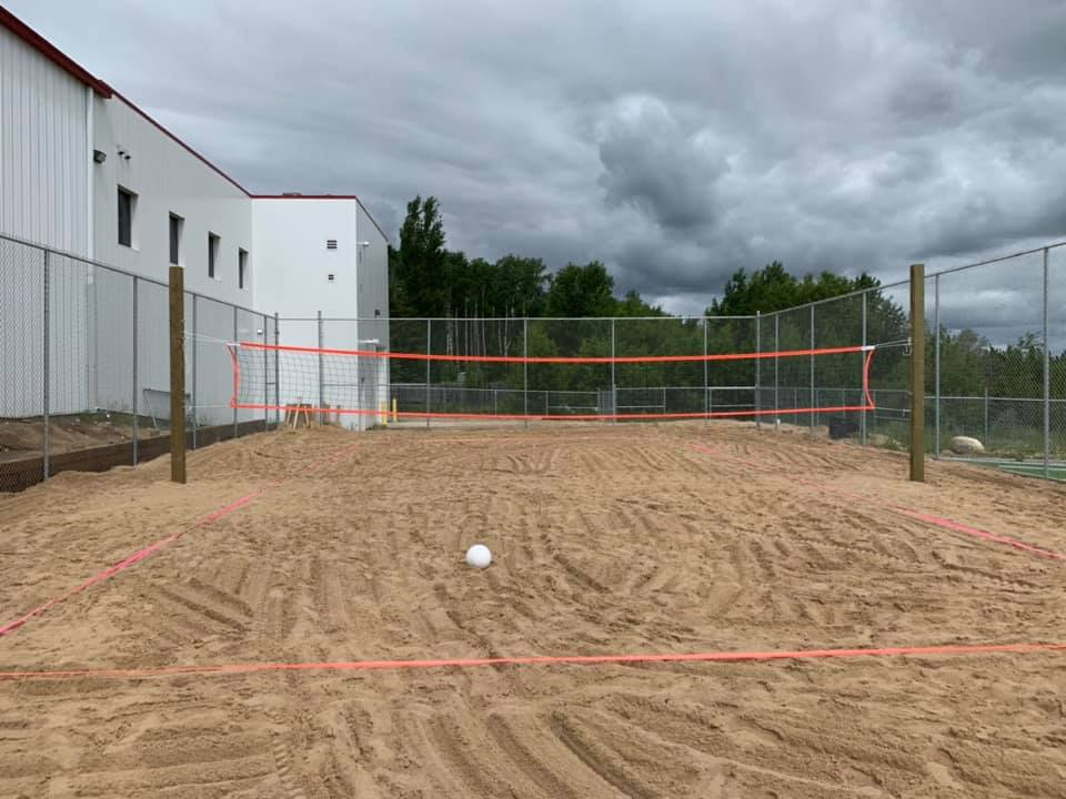 Outside beach volleyball court.