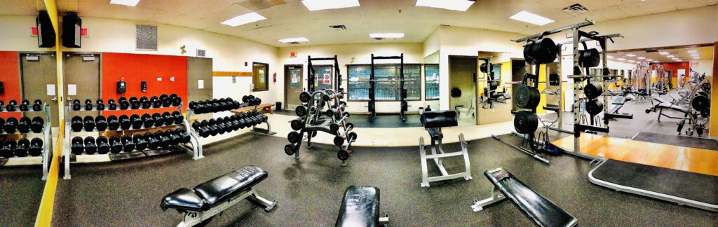 In the fitness center there are lots of free weights and benches to use to work different muscle groups.