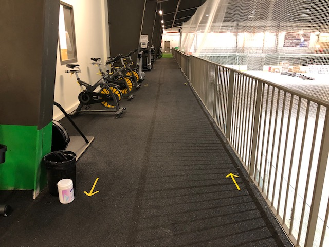 The jogging track has rails and plenty of space for runners.