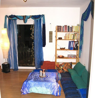 an Indian carpet strewn with cushions make the corner look authentic