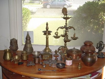 decorated the table with the collection of brass vessels or urns in indian style