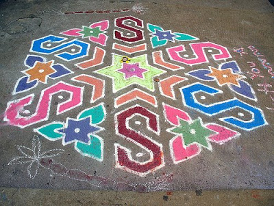 a colorful rangoli on the floor