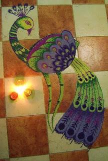 peacock rangoli made by rangoli powder and chalk