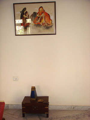 A painting hangs above the wooden chest