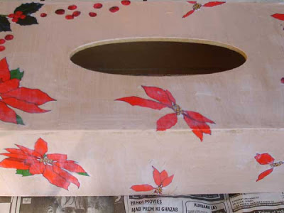 paste the flowers over the edge and onto the next face of the box