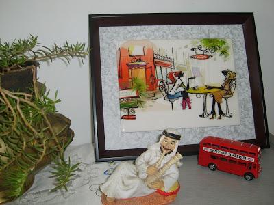 paris cafe representing the keybunch girls, london bus and arab man green pot