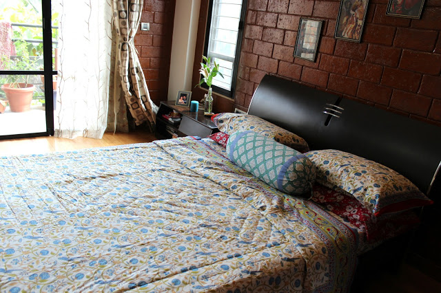 bedroom with light and cool bedclothes