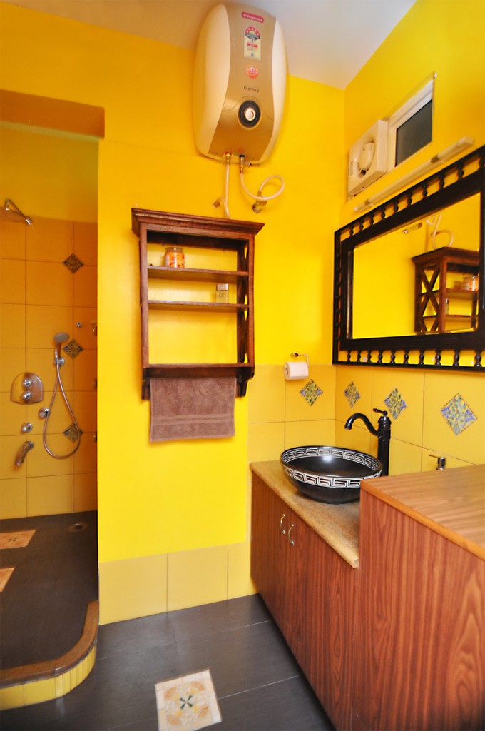 yellow bathroom, antique features, vanity