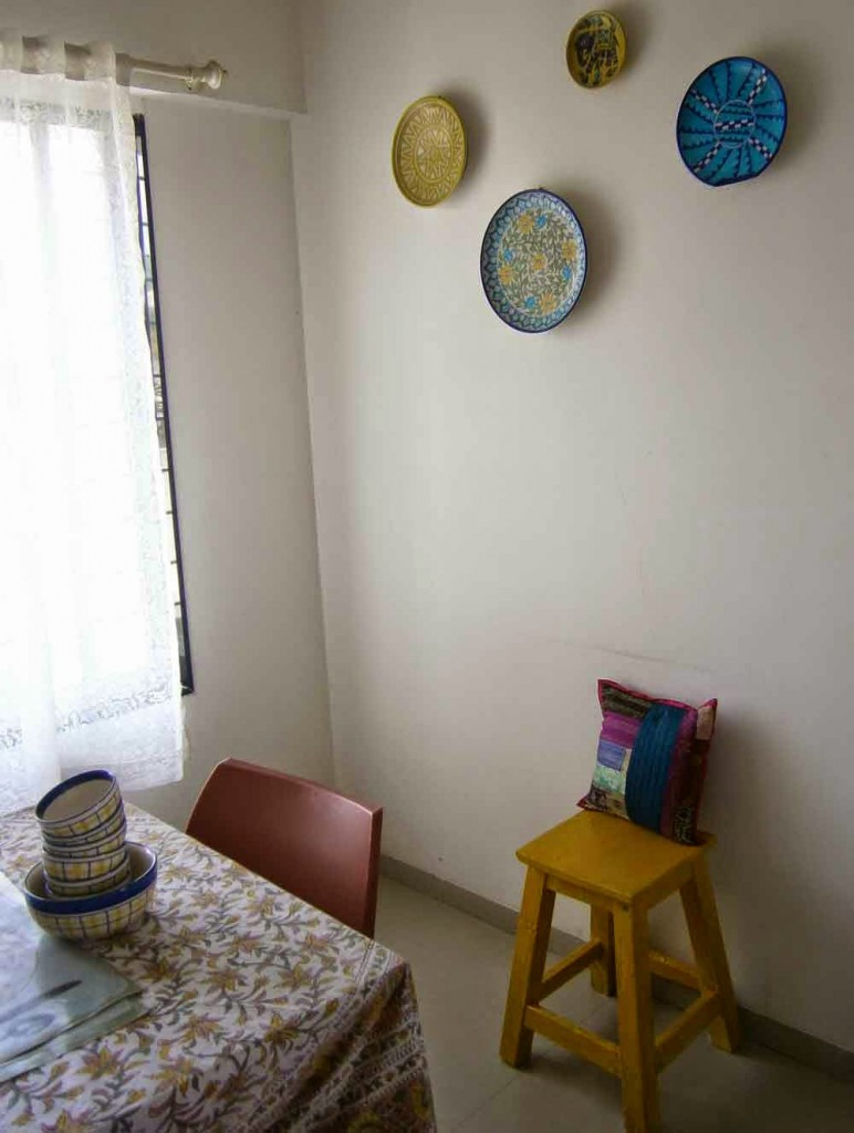 cushion and yellow stool
