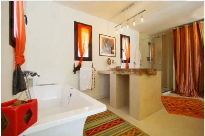 orange accesorries in french holiday home bath