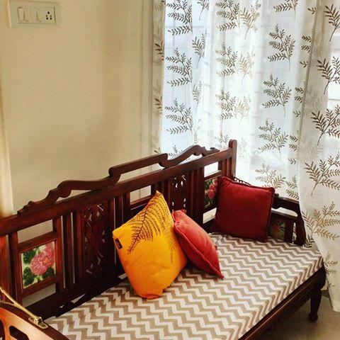 chevron bench with yellow cushion, fern curtains
