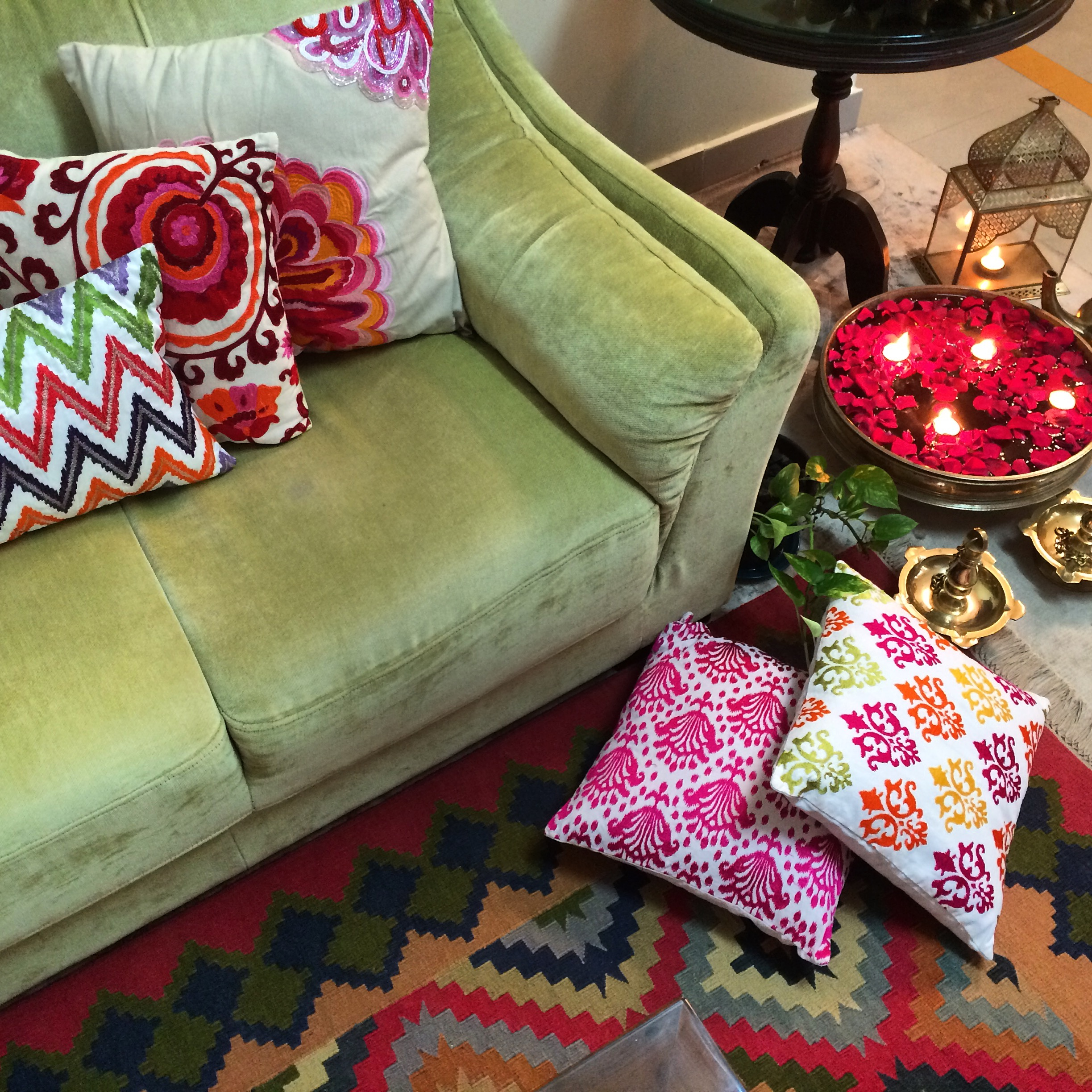 the living room with a colourful rug, brass Uruli and traditional oil lamps | Joseph home tour