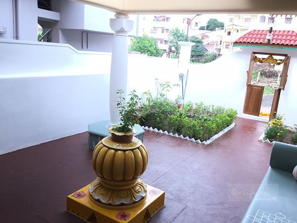 the courtyard is beautiful, garden plots and a tulsi in the middle | Home built in Old Style | theKeybunch decor