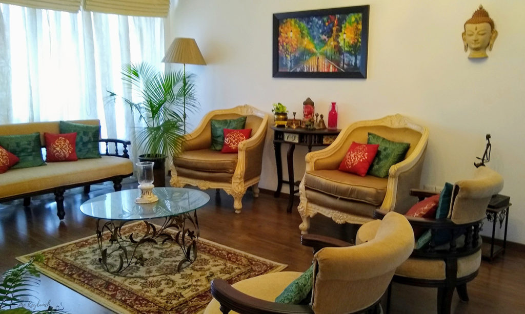 Jayashree Rajan's garden apartment tour on The Keybunch: The cream colored big chairs in the living room
