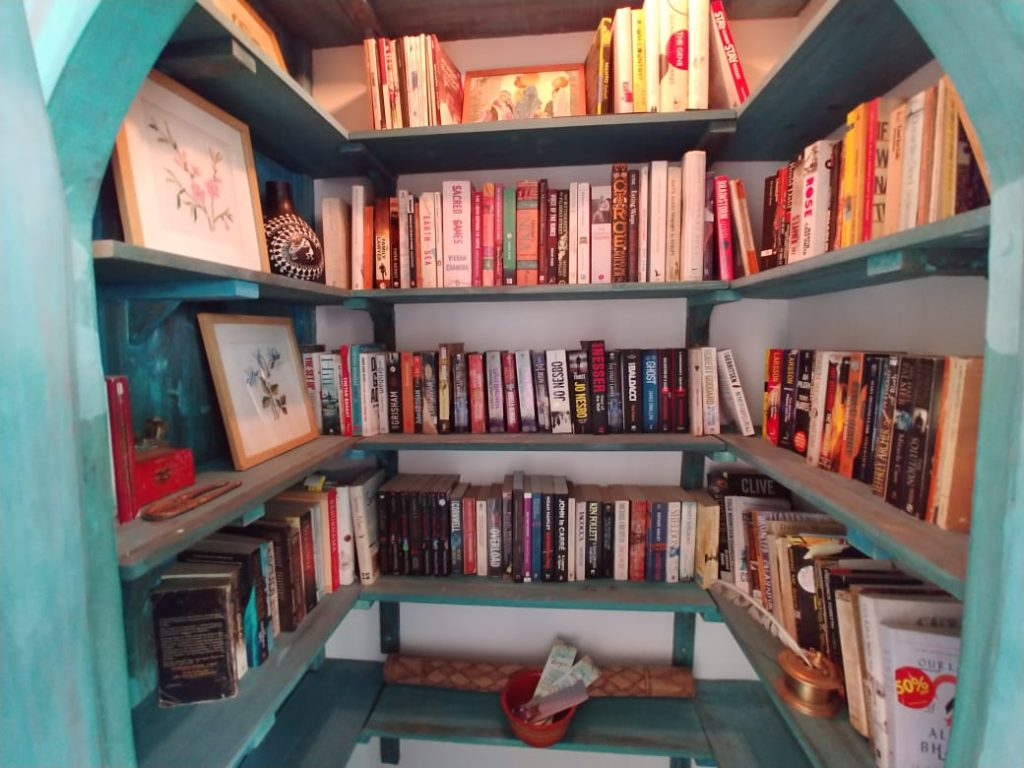 floor to cieling book shelves make this an interesting room to hang out in