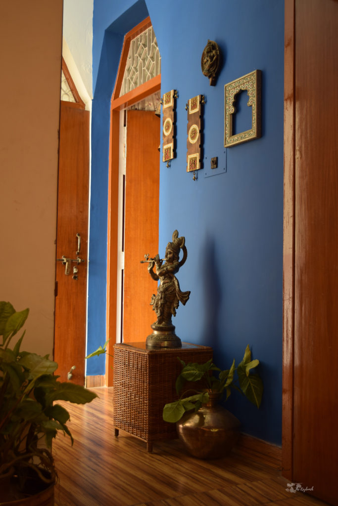 Home decor Tour by Ankita and Sitanshu's in Lucknow - cerulean wall with brass collection and wall gallery