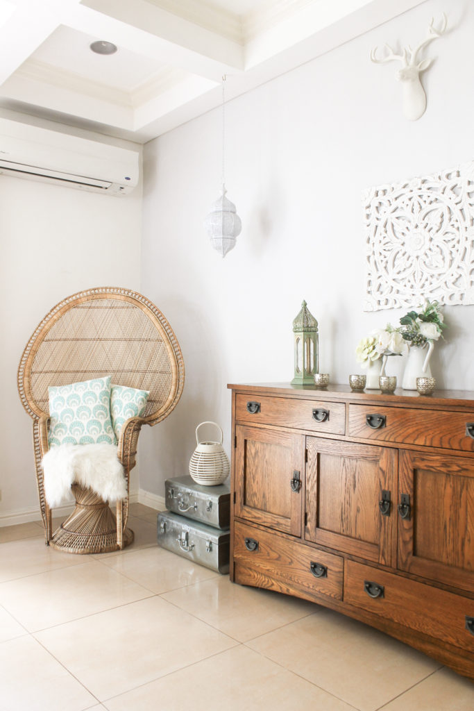 Home Tour with Kaho of Chuzai Living - the living room filled with rattan chair, desk chest, trunk, lamp and vintages